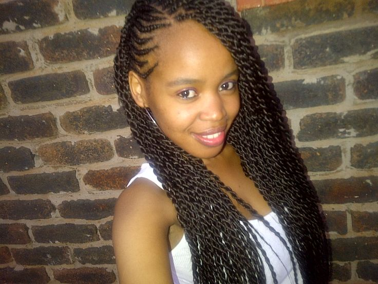 Beautiful! Long twists with side cornrows. Love it, this will be my daughter's next hairstyle.