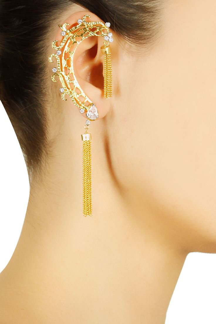 Gold finish cubic zirconium tassel earcuff style earrings available only at Pernia's Pop Up Shop...#perniaspopupshop #shopnow #rohitaanddeepai#accessories #jewellery #festive #newcollection
