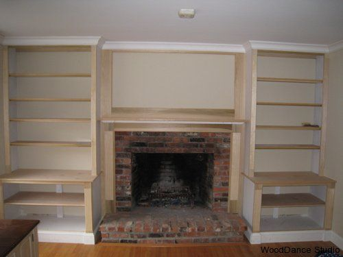 Fireplace with built ins and Built in shelves living room