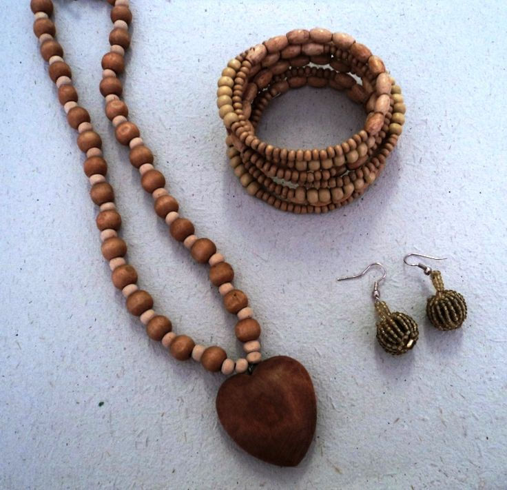 Wooden three piece, handmade and consisting of a necklace measuring 46 cm as well as a coil bangle and a set of beaded earrings. Simple yet stylish.http://www.ideasmarket.co.za/listing/4865/handmade-wood-and-bead-jewellery