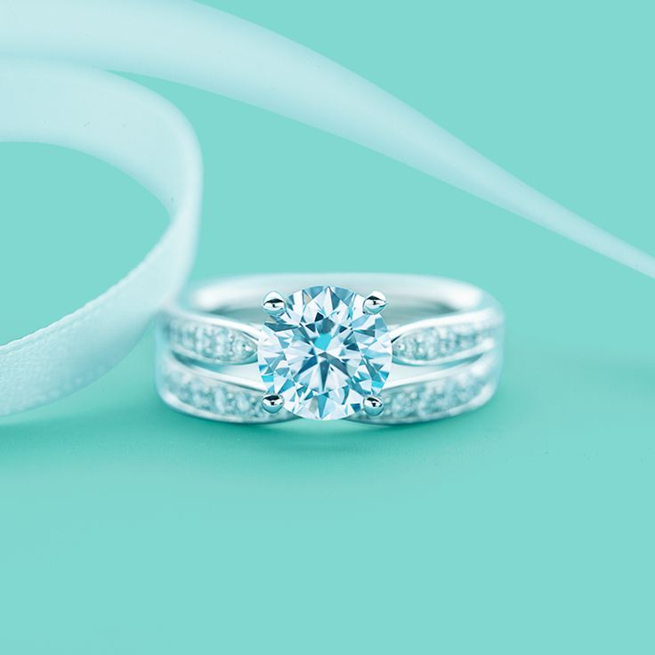 Beautiful Tiffany Harmony engagement ring with bead set border and matching band ring in platinum