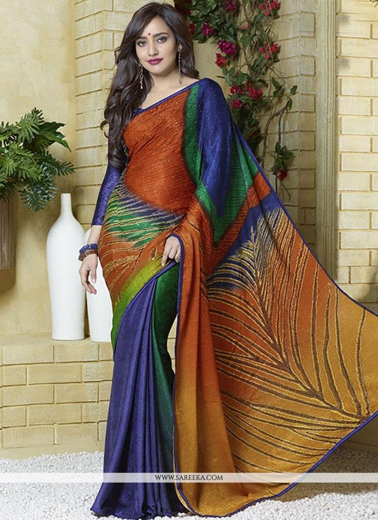 Neha sharma multicolor jacquard casual saree with embroidery, resham, printed, lace and patch border work. As shown an matching silk blouse comes with this.(Slight variation in actual color is possibl...