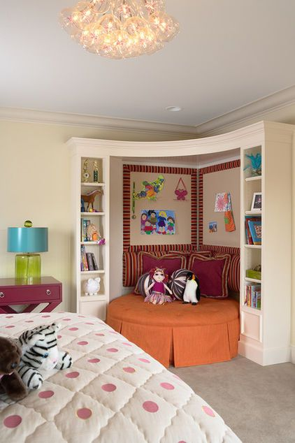 Conjure a special spot for curling up. Bookshelves and an oversize ottoman make a wonderful kid-size nook. Note the way the designer has added a roof across the top of this built-in. The same idea could be executed with beanbags on the floor and fabric across the top.