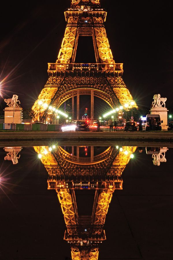 Eiffel Tower Paris France // The area under the Eiffel Tower is approximately 4 acres.