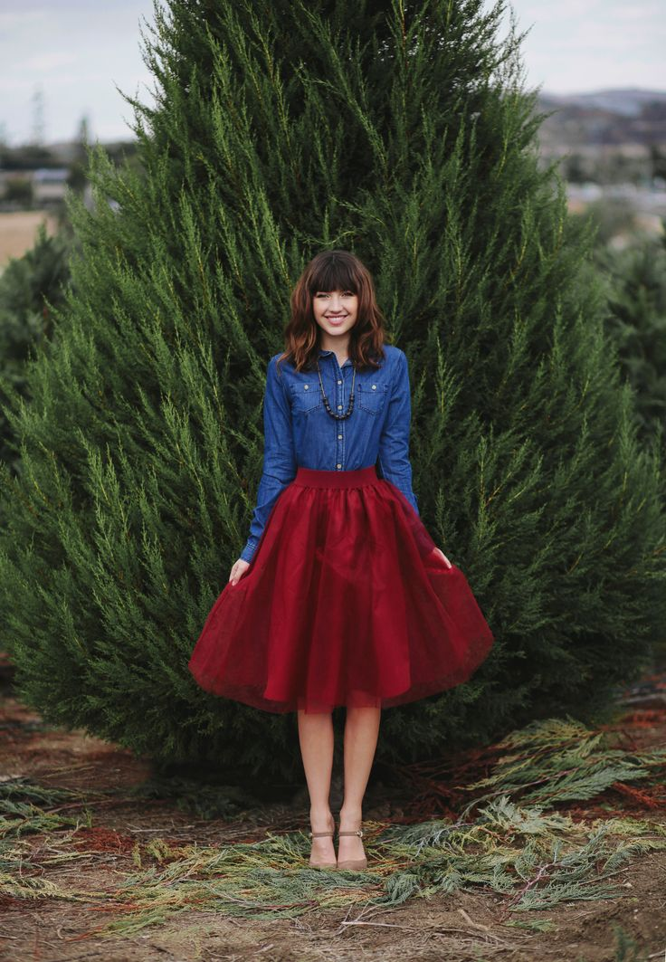 Nothing says festive more than a ruby red skirt and a denim long sleeve paired together.