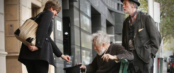 "Would you give this ""beggar"" money? A passerby in Melbourne, Australia, certainly did, offering an Aussie dollar to the bedraggled man crouching by the stage door of the Comedy Theatre in 2010. ==== Do you recognize the man?"