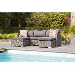 De vrolijke kleuren van deze kussens maken deze Hartman loungebank gelijk zonnig!