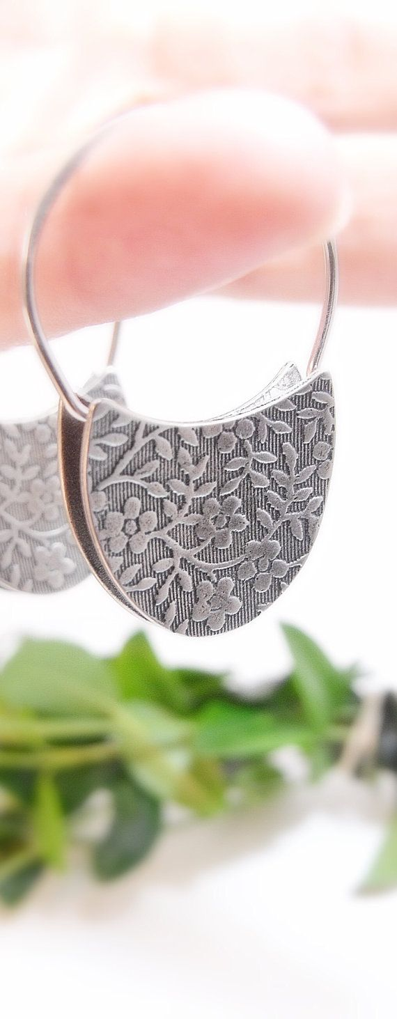 These beautiful sterling silver earrings wear as comfortably as a hoop earring. Just like my other padlock earrings, they are reversible with a different pattern on each side. One side is an Art Nouveau vines pattern, the other my Aloha design. They are a striking and unusual