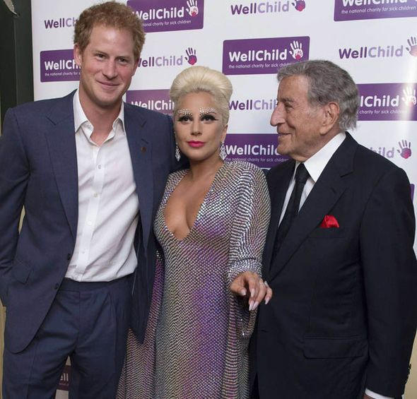 Prince Harry meets Lady Gaga and Tony Benett at the WellChild event on 8 June 2015.