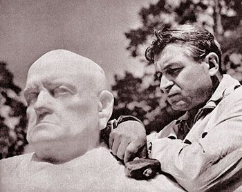 Made to last: the sculptor Wäinö Aaltonen (1894-1966) puts the finishing touches to a statue of the composer Jean Sibelius (1865-1957). Bo...