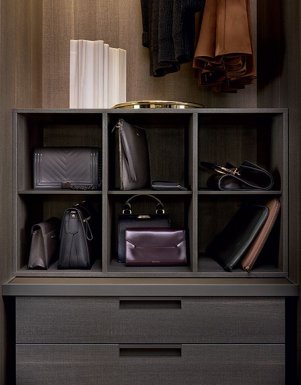 Handbag storage in cenere oak melamine with piombo mat lacquered inner shelves.