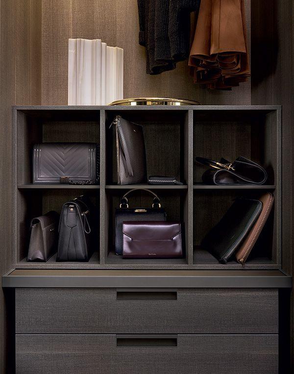 Handbag storage in cenere oak melamine with piombo mat lacquered inner shelves.