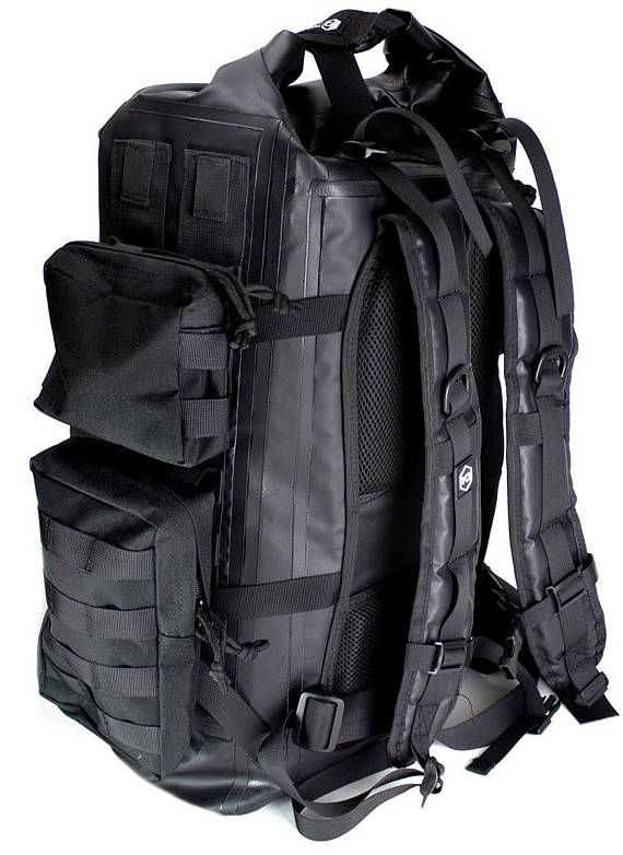 **Mission Darkness Dry Shield Faraday Backpack 40L - 5th Gen Shielding for Law Enforcement and Military**   About:  The Mission Darkness Dry Shield Faraday Backpack 40L is a multi-functional military-grade tactical backpack designed for shielding electronic devices during travel, in the rain or snow, and anywhere near water. The roll-down and clip shut waterproof backpack includes MOLLE webbing on three sides to accommodate multiple attachments for gear, snap-on MOLLE packs, carabiners, and…