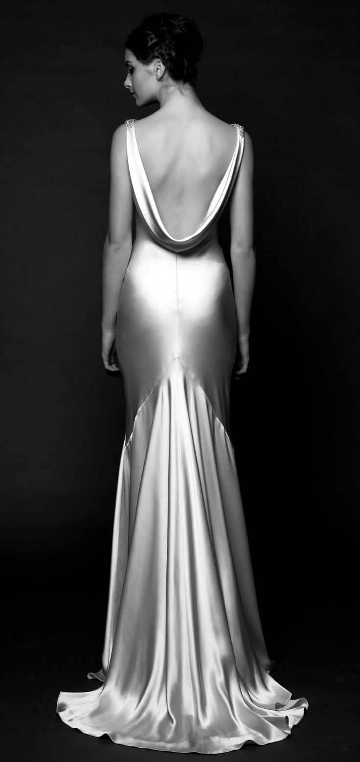 DAXA – wedding Gown, Fluid silk charmeuse and minimalist architectural seams sculpt Daxa's bewitching shape. Art Deco-inspired crystal details.