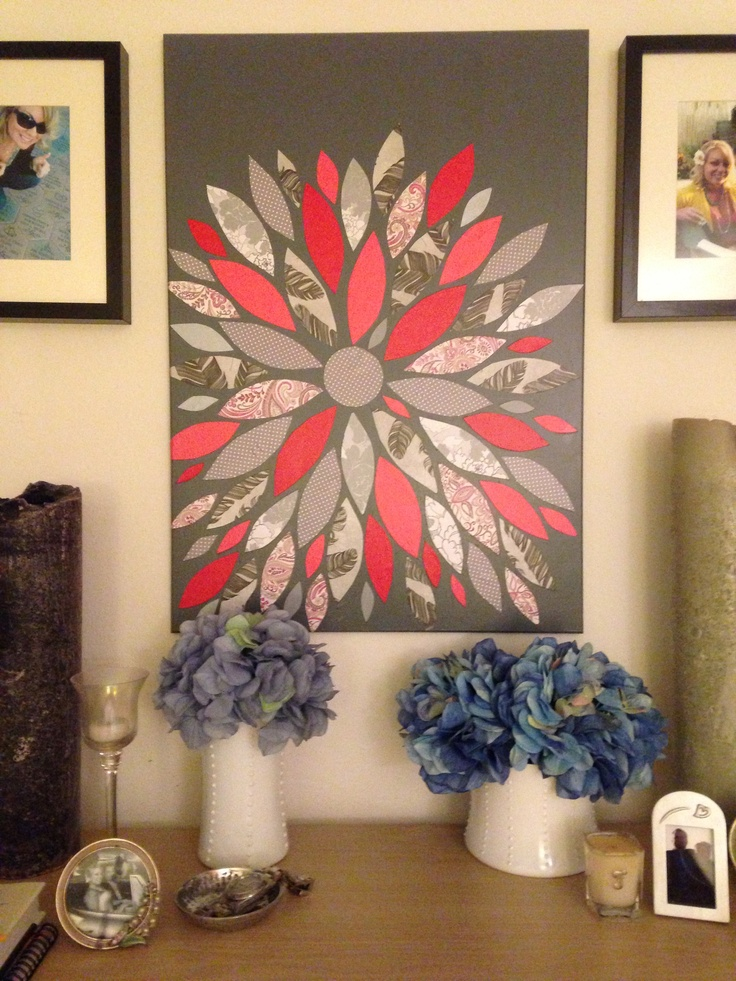Yet another DIY artwork for the bedroom! Easy!! I just cut leaf shapes from assorted scrapbook papers, mod podge to canvas (or painted wood- this used to be an old painting I painted over with acrylic paint.)
