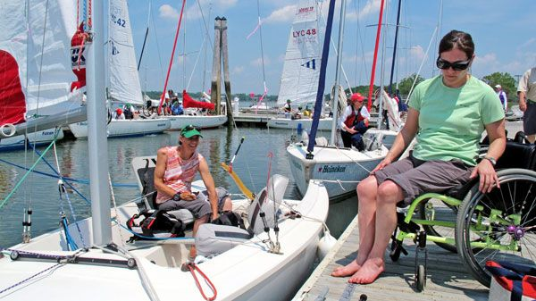 Sailors, Leave Your Wheelchairs Behind | Sail Magazine - Cindy Walker transfers into her Ideal 18 with skipper Sarah Everhart