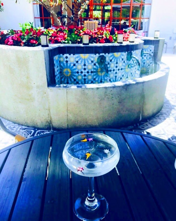 I am absolutely in love with the Four Seasons in Carlsbad CA and the Seasons Restaurant.  I let my waiter know that I'm loving that low carb life but I wanted a drink.  He brought me this beautiful drink. Lychee infused vodka with flowers.  Super cute.  #lychee  #lycheevodka #vodka #instaalcohol #instaflowers #relax #drinks #happyhours #happyhoursandiego #sandiego #fourseasons #foodie #beautiful #picoftheday