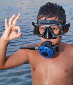 What Is the Minimum Age for Scuba Diving?: Children as young as 8 years old may sign up for scuba diving lessons.