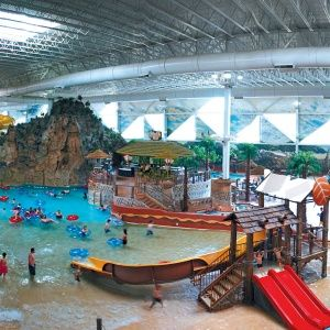 Wisconsin's Indoor Water Parks Getaway from: Chicago  The Midwest is often covered in snow in the spring. But the self-proclaimed water-park capital of the world, Wisconsin Dells, in central Wisconsin, scoffs at weather forecasts. Eighteen indoor parks include some of the country's largest, and draw more than 2 million people each year. Perfect if you want to go swimming but can't get to warm weather.