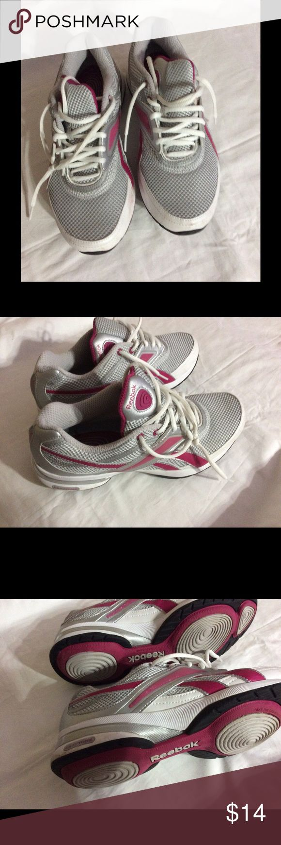 Reebok- woman's tie up sneakers Reebok- woman's tie up pink and gray sneakers. There is a small stain on the outer left sneaker. You can see from the bottoms they were hardly worn. Enjoy Reebok Shoes Sneakers