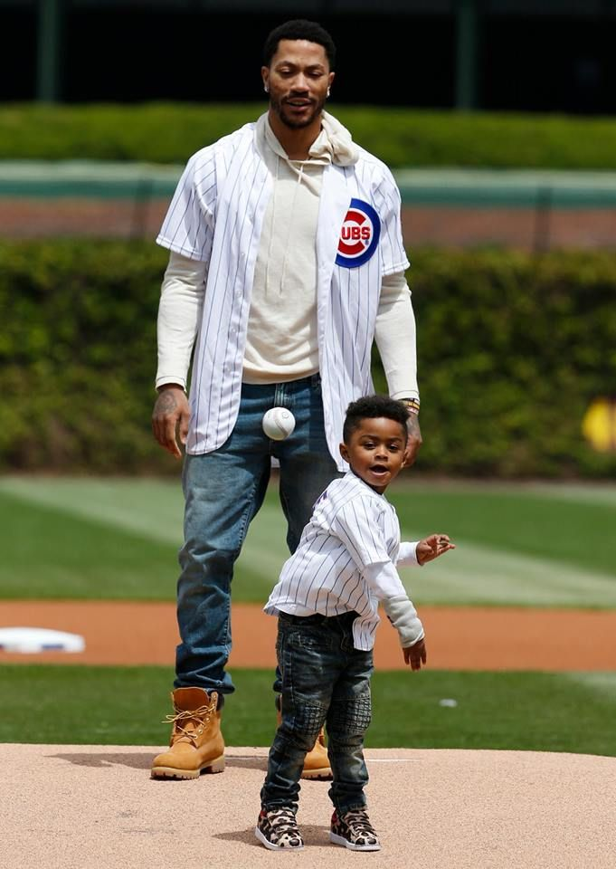 Derrick Rose had a little help with the first pitch at Sunday's Chicago Cubs game.