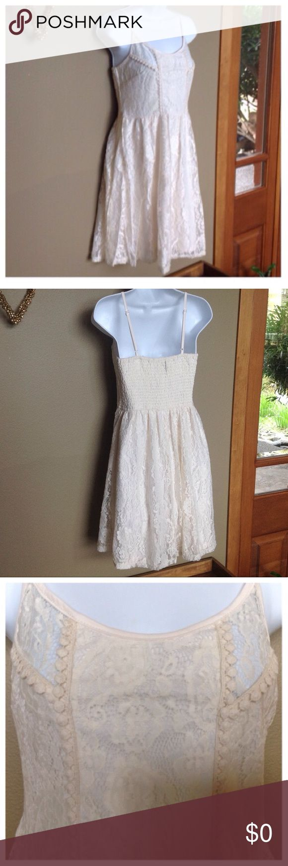 """🍃💕Floral Lace Fit & Flare Strapless Dress Ivory Gorgeous fit and flare floral lace overlay dress in Ivory. Features scoop neck with adjustable spaghetti straps, rear smocked bodice ensures a beautiful fit, fully lined. Pieced front bodice adorned with crochet accents. Stunning💕Just throw on and go for effortless style. Comprised of an easy care stretch blend of 55% cotton, 45% nylon. Shoulder to hem approximately 36"""". Available is Sizes: S/2-4, M/6-8, L/10-12. No trades ever Dresses Midi"""