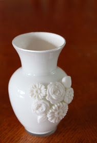 Milk Glass Vase Using Mod Melts, by The Experimental Crafter  Enter Mod Melts.  Basically, you buy these special hot glue sticks that you can put in your normal hot glue gun.   You then use the melted glue to fill a mold and make an embellishment.    I started with a clear glass vase from Goodwill.   I squeezed a bunch of white acrylic paint into it and started rolling it around to fill the inside.  Once covered, I set this aside and started working on the Mod Melts.    Stick glue stick…
