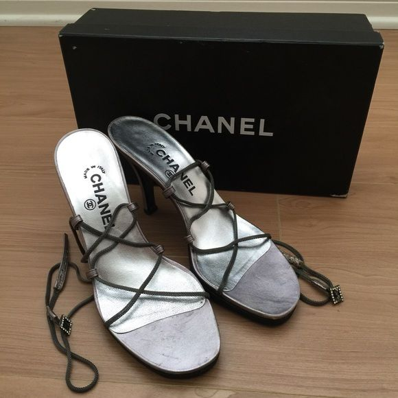 ⬇️CHANEL Authentic Silver Ankle Wrap Heel Sandals These are 100% authentic metallic silver tone leather Chanel strappy ankle wrap sandals with embroidered logo at covered heels and buckle closure at chain straps. Condition: Like New. As seen in photos. Comes with original box. Heel height: 3.5 inches. Vibram soles were added for additional support at the base. Size: 38 but fits a 7.  trades. CHANEL Shoes Heels