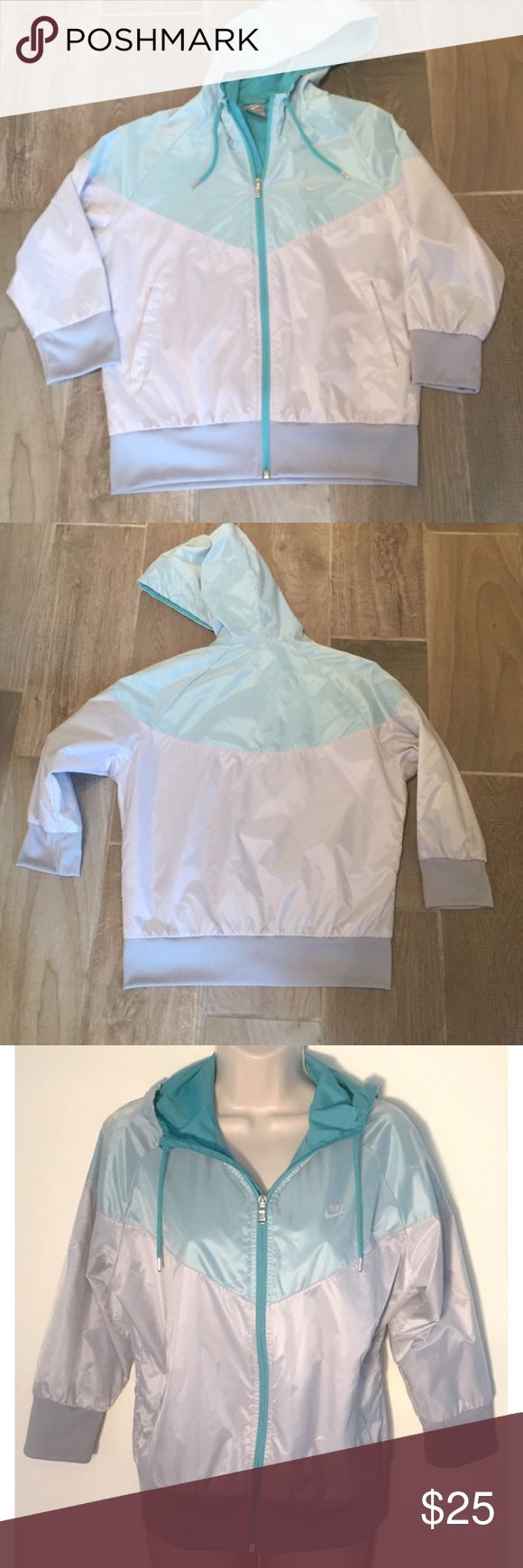 """❣BOGO 1/2 off❣🆕Nike youth lightweight jacket NWOT, flawless. Silvery gray & turquoise blue colors with silvertone hardware. Light, windbreaker-type material. Fully lined. 2 front pockets. Large. Could also fit a women's XS if you have shorter arms or want a cropped sleeve look. Approx 24"""" long, 21"""" flat across chest, & 19"""" sleeves. ❣Ask me how to BOGO HALF price! Nike Jackets & Coats"""