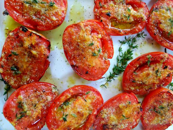 It's late August when tomatoes are in abundance, and here's yet another favorite way I like to serve them. It's an old recipe adapted from BBQ King, Steven Raichlen's, Garlic Grilled Tomatoes. I think in his original recipe he stuck a sage leaf on top of each tomato half, which is wonderful as well but …