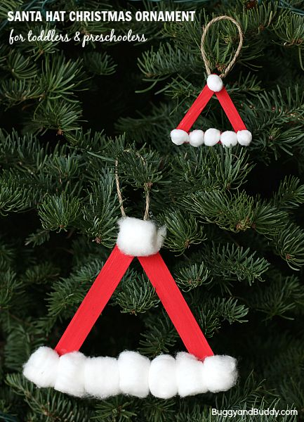 Source: BuggyAndBuddy.com 7. Santa Hat Here's another great ornament for your young children. All you need to do is form a simple triangle, have the kids paint the sticks red and then glue on some cotton balls! It's easy and very inexpensive and makes your kids feel like a big part of decorating the tree.Continue Reading...