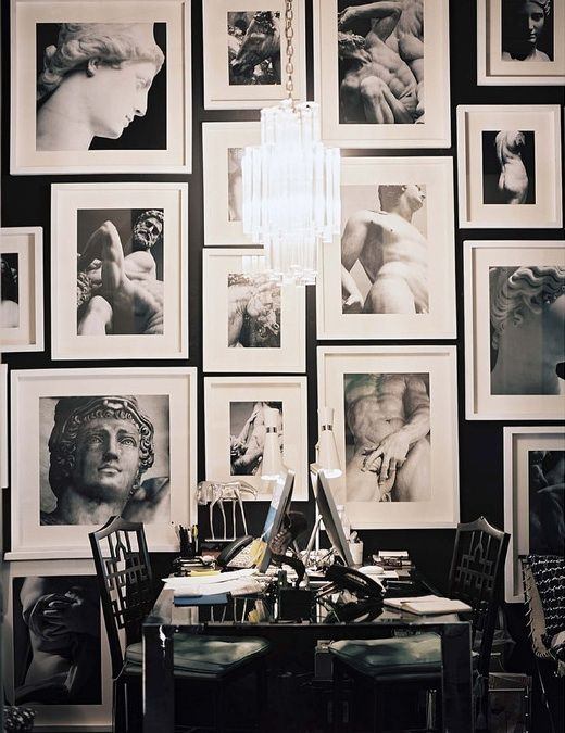 Display What You Love. B photography in all white frames against a dark wall.
