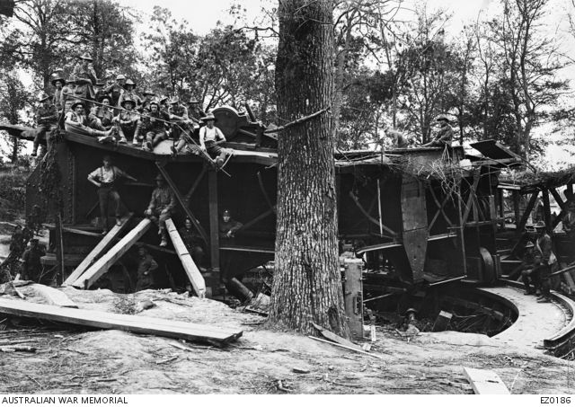 A group of unidentified Australian soldiers of the 3rd Battalion pictured on and around the base of the German 15 inch naval gun that they captured in Arcy Wood during the Battle of Proyart on 23 ...