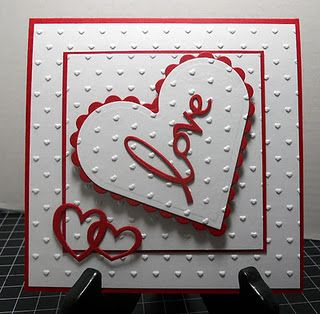 handmade Valentine card ... white with red mats and die cuts ... lots of embossing folder dots .. like the script LOVE die cut ... like it!