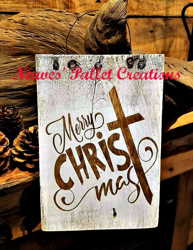 """RECYCLED WOOD PALLET: We Love this design for the Greeting """"Merry Christmas."""" You could hang this on your tree, a door knob or just display it on a wall. If you are a crafter, you could work into a part on a wreath. This sign is 8"""" x 5.5"""" and we are asking $5 for it. They would make great teacher gifts, especially for your Sunday School teacher. It would be a wonderful """"secret pal"""" gift too. Message us if you would like to place an order for one. Item # 1,254"""