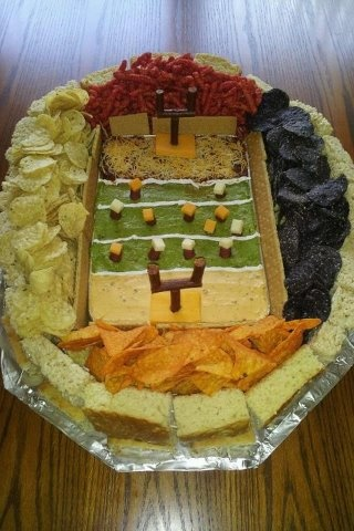 Iowa State (fiery Cheetos and Nacho Doritos) VS. Iowa (Blue Aztec chips & Tostitos) Field: Giddyup Guacamole Yard Lines: sour cream in a ziploc bag, snip corner & squeeze for thin lines. End zones: Corn Black Bean Salsa & shredded cheese, Chipotle Queso Dip Goal Posts: beef sticks (cut beef sticks and cheese cubes for players) Foundation: Bountiful Beer Bread cubes to hold it all together