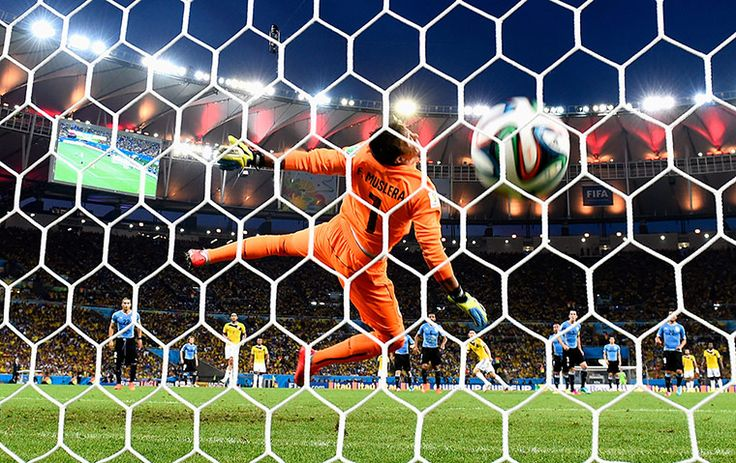 James Rodríguez's volley for Colombia against Uruguay was arguably the goal of the tournament and this vibrant photo neatly captures the dra...