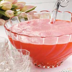Red Cream Soda Punch  (Serves 28)  4 quarts cold water  2 cans (12 oz each) frozen orange juice concentrate, thawed  1 can (12 oz) frozen lemonade concentrate, thawed  1/2 cup sugar  1 bottle (2 liters) red cream soda, chilled.