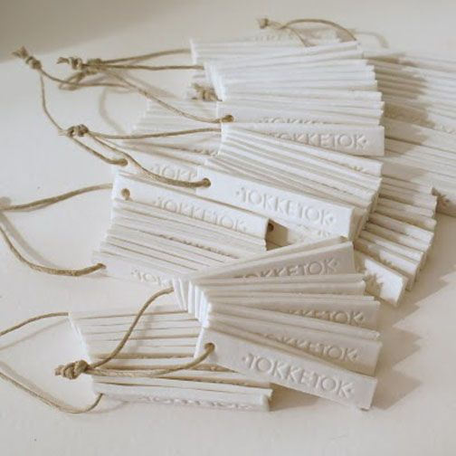 Clay tags, made ahead in large batch. Use many different shapes, hearts, stars, circles...