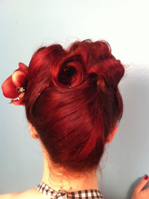 pinup hair, victory rolls can be created for the back too.