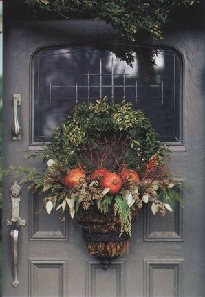 I really like to fall greenery with pops of subtle colour, instead of a traditional door display.