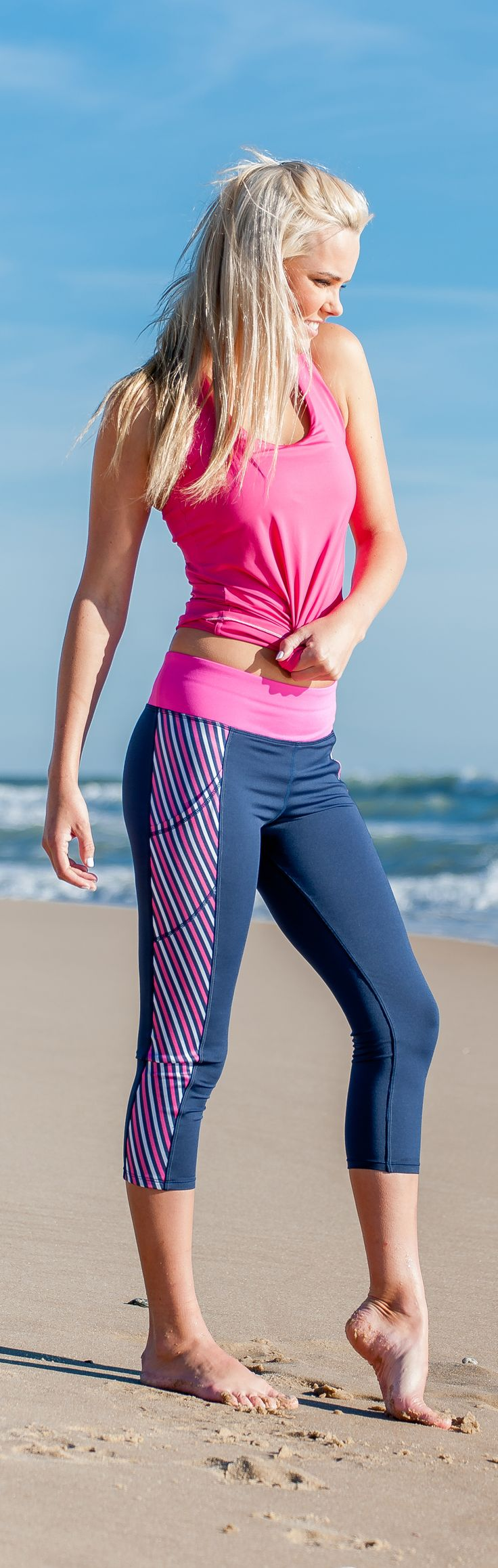 Yoga pants with pockets big enough to hold your phone? Yes please! Our bestselling navy & pink stripe capris are not just the cutest around, but also super-functional. The TWO big side pockets can hold keys, money, iPods, phones - you name it! Shop them now at devonmaryn.com.