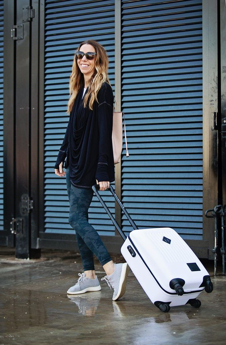 The Motherchic wearing an easy travel outfit - camo spanx and herschel luggage #traveloutfits