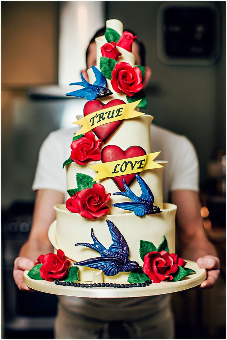 Tattoo theme wedding cake with hearts, roses and swallows by Ben The Cake Man | Steve Gerrard Photography
