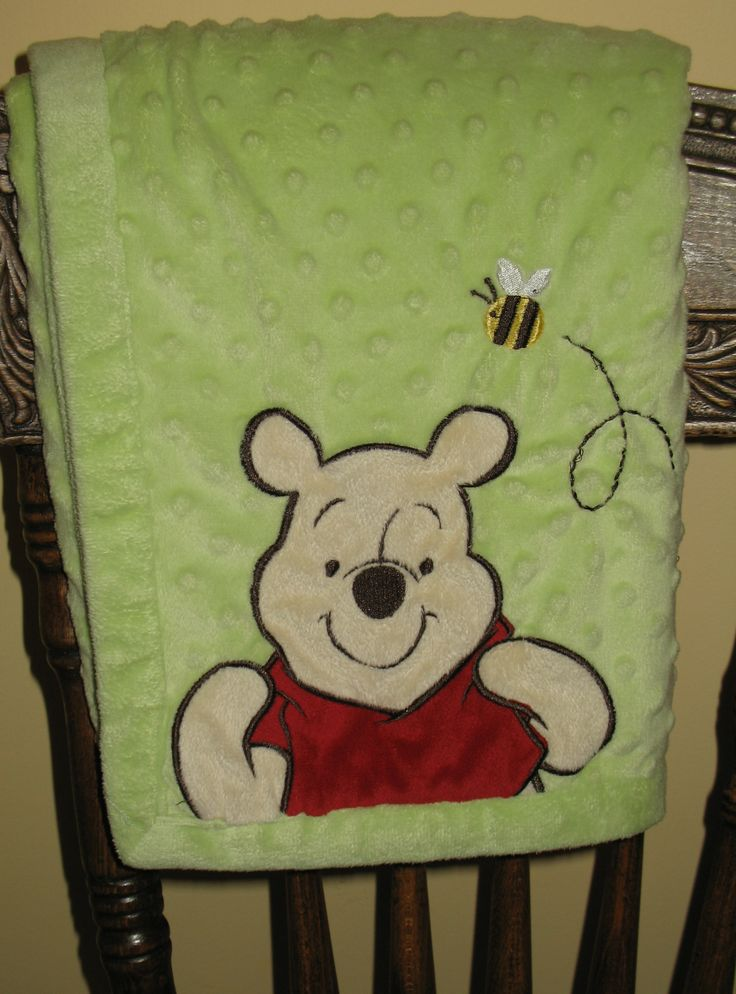 Love this classic Winnie the Pooh plush baby blanket. It is a medium shade of green with a sweet image of  Pooh with raised dots and a buzzing bumble bee!  It is perfect for babys nursery. #winniethepooh #babyblankets #ck $49.95 | See more about green baby, bumble bees and plush.