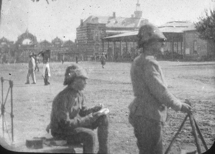 Tommy Atkins and fellow serviceman on the market square...Bloemfontein ........ABW.. ( magic lantern slide ) Nico Moolman