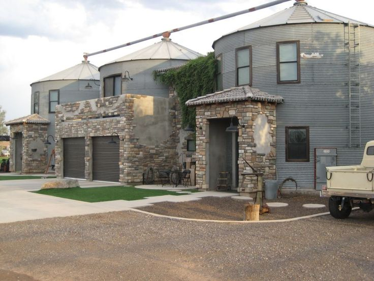 This may look like a row of converted townhouses, but it's actually two residences that share a central garage. Click through to take a peek inside this and other silos converted into non-traditional houses.