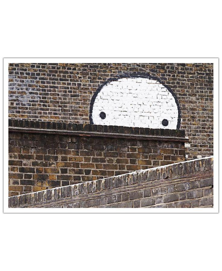 Brick wall. Streetart Mauer by Sadia Art Print now on Juniqe.com | Art. Everywhere.