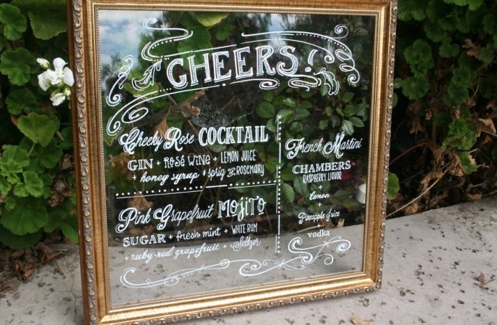 For a vintage touch write the bar menu on a gilded gold mirror at your wedding reception.