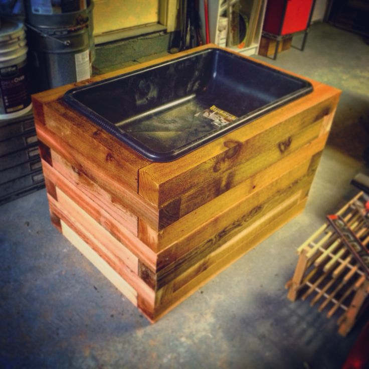 Cedar planter box made of 4x4s and cement mixing tray.
